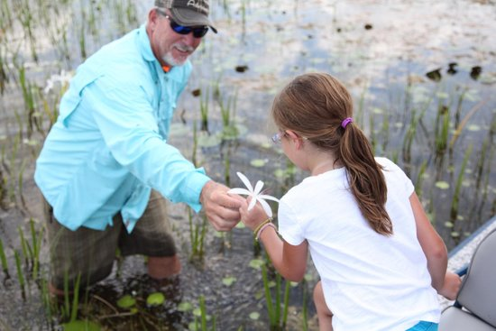 Everglades River of Grass Adventures -Tours: Robert giving a flower to the birthday girl