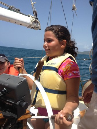 Vieques Classic Charter - Tours: One of our young sailors learning how to navigate