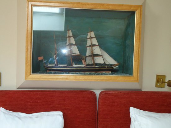 Victory Hotel: An antique model of a sailing ship in our room