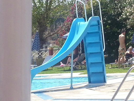 Spiros Apartments: pool slide