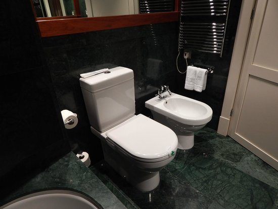 Hotel 1898: Marble bath/shower with toilet and bidet.