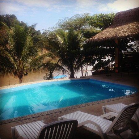 Hotel pool overlooking river