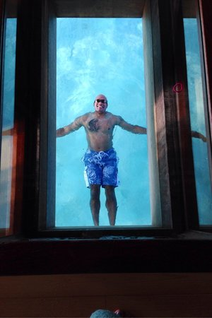 InterContinental Bora Bora Resort & Thalasso Spa: A picture of me swimming thru the glass coffee table and glass floor in our bungalow over the wa