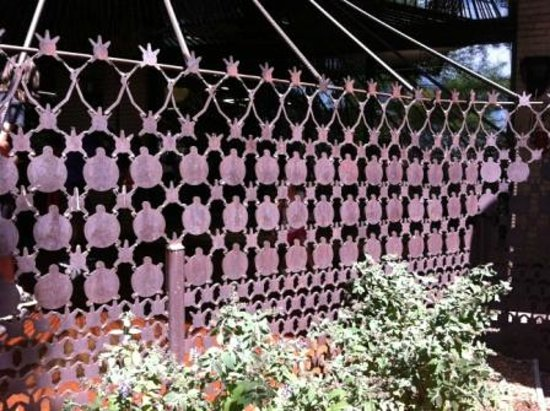"City Museum: fence made of ""leftover"" metal punch pieces"