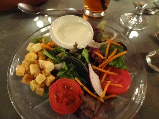Casa Rustica: Salad with dressing.
