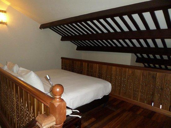 Hotel Penaga: lit à l'étage