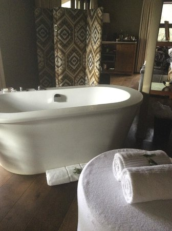 Kapama Buffalo Camp: soaker tub with bath salts in beautiful room overlooking wildlife