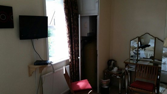 The Cavendish: Boiler and water tank placed in the corner of the room, that kindly kept the room intolerably ho