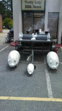 True BBQ: Pigs cooking in the parking lot