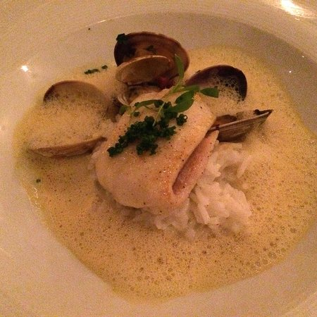 Redd: White fish with rice, clam sauce foam, clams, diced chorizo