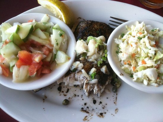 The Speckled Trout: Mahi-mahi, hidden under bowls of cucumber salad and cole slaw