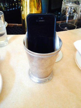 Maison Premiere: my cell phone in a mint julep cup (a lat the bartender)