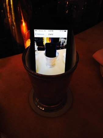 Maison Premiere: a photo of my phone in the cup on my phone in the cup...