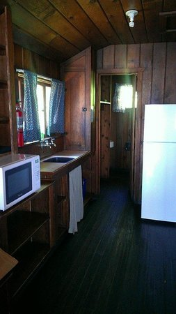 Cama Beach State Park: Kitchen and bathroom of deluxe cabin