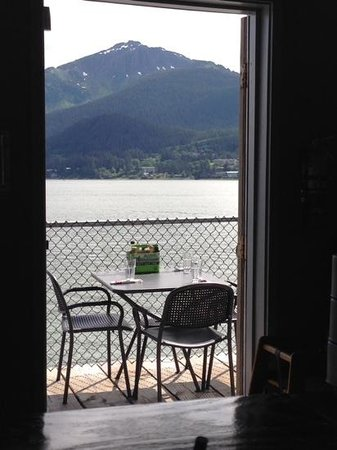 Hangar On The Wharf: patio area is also outside with a nice view of the water and mountains