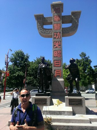 Tour Guys Vancouver: Our guide, Ali, in front of a Chinatown statue