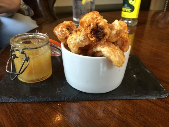 The Grill & Smokehouse Restaurant: Hot Pork Crackling with Apple Sauce, nice whilst you look over the menu