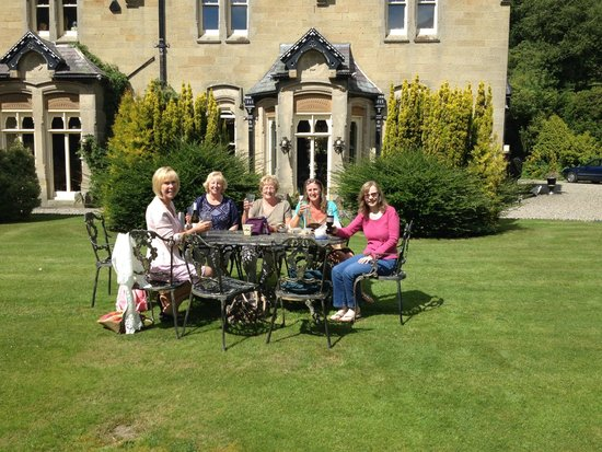 The Hall at Abbey-Cwm-Hir: Our very happy group enjoying picnic (and wine) in the grounds