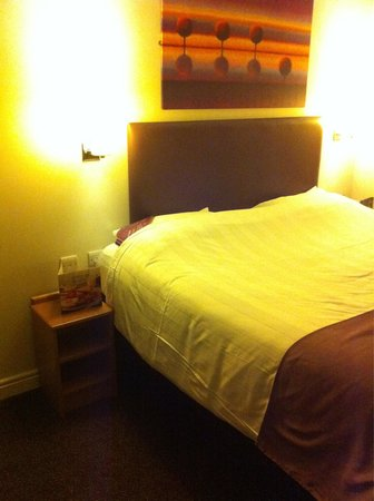 Premier Inn Newcastle Quayside: Sad looking bed. I wasn't sure I could bring myself to crawl into the sheets.