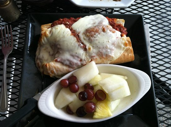 Victoria's Restaurant and Wine Bar: Open face meatball sandwich with fruit in foreground