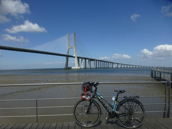 Bikeiberia Bike Tours & Rentals: bike from Bikeiberia in front of Vasco de Gama bridge