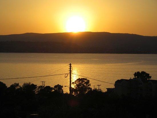 sunset over lixouri,photo took from nikostudios,lassi