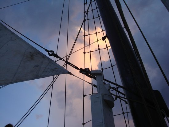 The Jolly Roger: View of the sun setting through the ropes