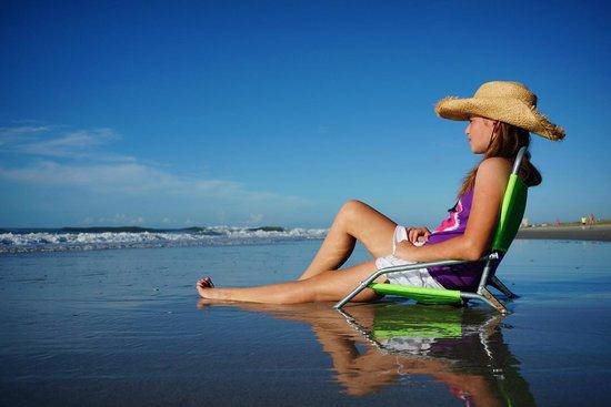 Dunes Village Resort: My 11-yr-old daughter, on the beach in front of Dunes Village
