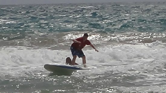 Bob's East Island Surfing Adventures: B (13 yrs) got the hang of it and was off and going.