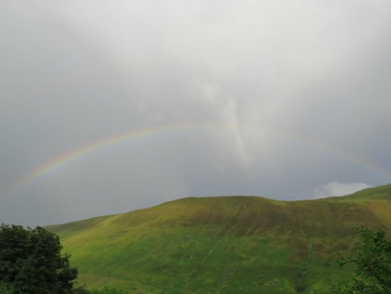 The Old Rectory on the Lake: A rainbow over the hills across the lake