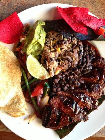 Escobar's Restaurant : Hanger steak asada with fajita vegetables, pepian sauce, pico de gallo, guacamole, tortillas, an