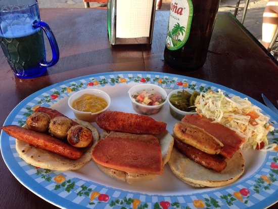 Restaurante Comidas Tipicas y mas... : This is the Corizada, a sausage dream and my favorite. Get extra mustard and jalapeños!