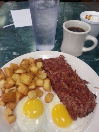 Clary's Cafe : Beef brisket hash, eggs sunny side up