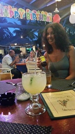 Vagabundos del Mar Trailer Park Restaurant: My friend Carol enjoying her beer, behind my generous Margarita!