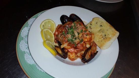 Over the Edge: seafood marinara fetuccini w/ garlic bread