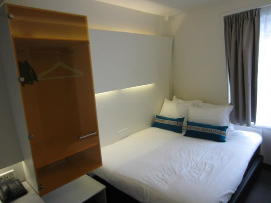 Ibis Styles Amsterdam Central Station: 5th floor room with window in sloping wall over the bed - curtains do not cover the window