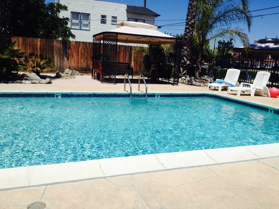 Cinderella Motel: Our guests love to swim in the pool, tan on the deck and socialize under a shaded cabana!