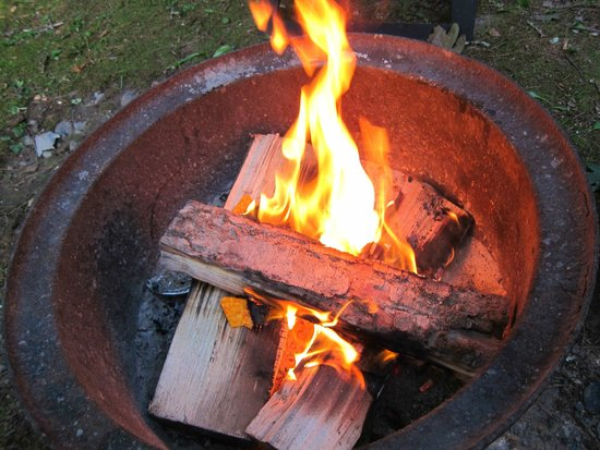 Kittatinny Campgrounds: fire ring - seems like a chopped off steel rim