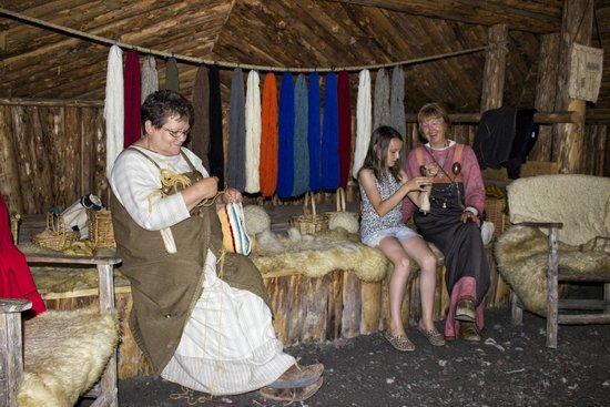 Norstead Viking Village: Granddaughter getting some lessons from the ladies there. Those ladies are remarkable!