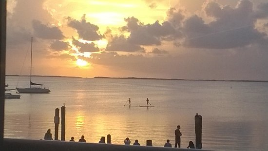 Bayside Grille & Sunset Bar: Sunset 7.25.14 with paddle boarders