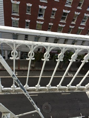 Hotel Bijou: Fire escape outside window with no screen next to bed
