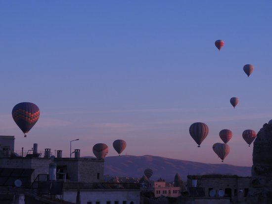 Balloon over the township of Goreme - Picture of Goreme ...