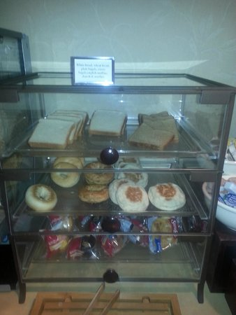 Country Inn & Suites By Carlson, York: Selection of fresh breads, bagels, muffins and dessert cakes