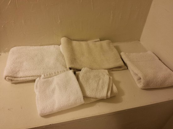 Travel Inn: Towels were discolored. Some towels had red stains on them. Ended up using my clothes instead.