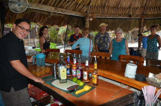 Utopia Village : The palapa bar, with Debbie Mylius on the left.
