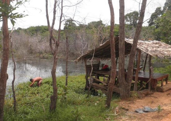 Neak Pean: Musician takes time off to go fishing on a quiet day for visitors