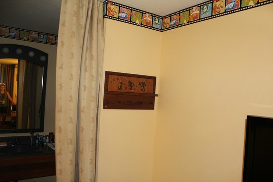Disney's All-Star Movies Resort : Room divider for sink area and Disney coat rack.