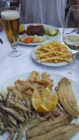 Ristorante La Punta : Asorted grilled lake fish / steak in the back