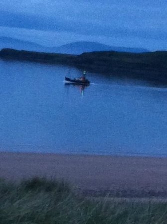 Sands Caravan & Camping Park: Fishing boat passing at night