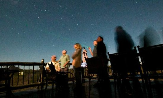 Victoria Falls Safari Club : Guests enjoying a star-gazing educational talk in the evenings at the Club lounge deck area